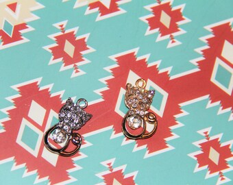 The gold with silver rhinestone cat charm