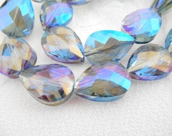 A set of 6 glass Teardrop beads faceted blue AB.