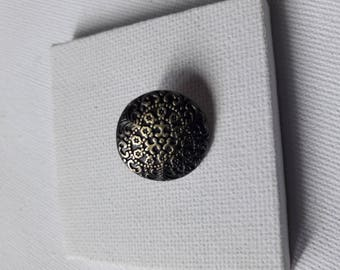 Button sewing antiqued bronze patina.