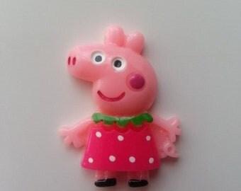 cabochon en résine  cochon rose pepa 25*35mm