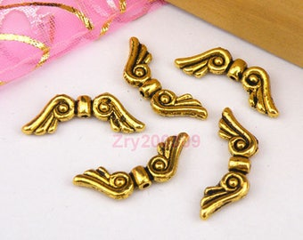 12 wings in antique gold metal beads