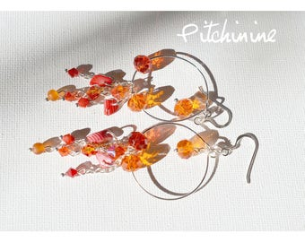 Fake Hoop, shades of Orange and pink crystals Swarovski and sterling silver findings.
