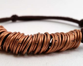 Copper rings and leather bracelet