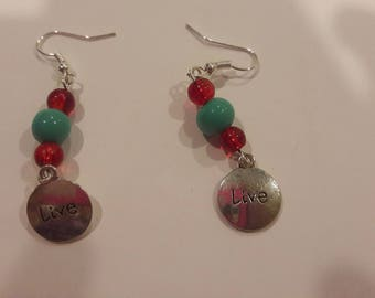 Live charms with red and blue beaded earrings