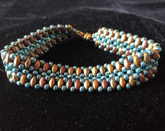 Lovely handmade bracelet in rainbow iris superduos and duracoat seafoam glass beads