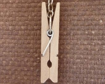 Pendant made of wood clothespin.