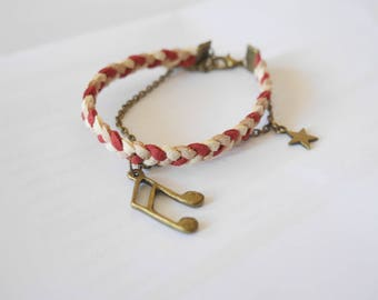 Red and beige suede braided music note bracelet.