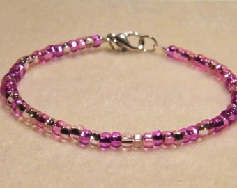 Assorted pink glass seed beads bracelet