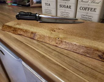 Solid oak live edge cutting board's