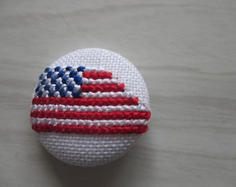 "Custom button embroidered ""Flag and stripped now"""