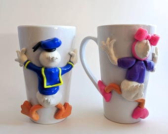 Donald Duck and Daisy Duck large mug set done in polymer clay.