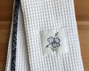 Handmade hand towel with Forget-me-not flower motif hand-embroidered by Apples N' Thyme