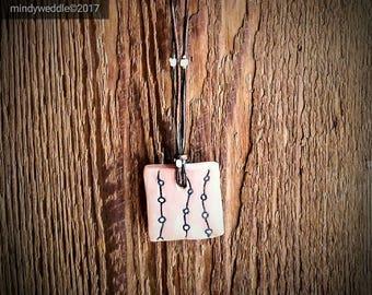 Necklace with porcelain pendant