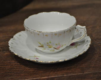 Tea Cup & Saucer - Unmarked - White Fine China - Gold Leaf Details - Pink and Blue Flowers