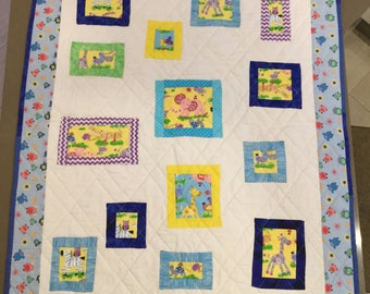 Cosy cot quilt for baby boy