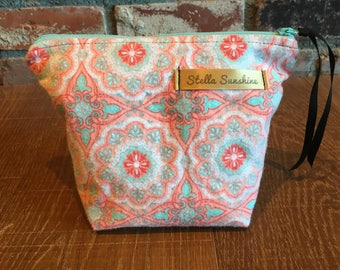 arabesque geometric pattern, coral, salmon, teal turquoise handmade flannel makeup bag, cosmetic pouch, toiletry bag