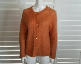 Hand knitted cardigan in apricot