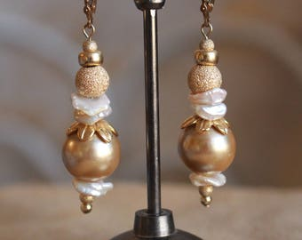 White disc pearls and gold earrings