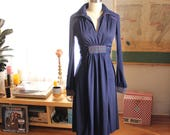 navy blue jersey 1970s dress by Jody T of California . 70s belted dress with high waist, v neck collar, rainbow stripe stitching
