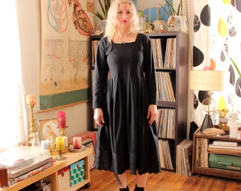 1980s vintage black smock dress with scalloped eyelet hem, long sleeve midi dress . womens small