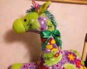 Giraffe in multicolor fleece. Safety lock eyes. Hypoallergenic stuffing. Measures 25 long. Yarn main n tail.