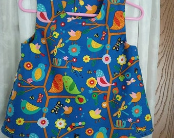 Girls 3T cotton summer top in Multicolor springtime friends novelty print on blue background. Sleeveless. Snap back.