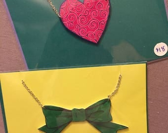 Heart and bow necklaces