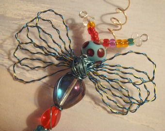 "My #9099 A Bug Eyed Pretty Blue/Red Alien Fluttering Dragonfly!.. Ornament! Size 3""Wx4""L"