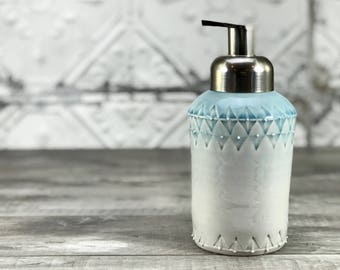 Foaming soap dispenser. Blue ombre glazed porcelain soap dispenser.  Unique stamped pattern. Brushed nickel finish foam pump. Blue bathroom.