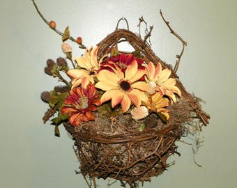 Grapevine Birdhouse filled with Gold, Amber, Rust, Brick Red Flowers