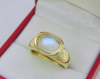 AAAA Blue Moonstone 2.74 carats  10x8mm in 14K Yellow gold bezel set ring.  255