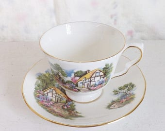 On Sale Vintage Queen Anne cottage and garden tea cup and saucer set English china made in England