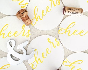 Set of eight Yellow Cheers letterpress coasters