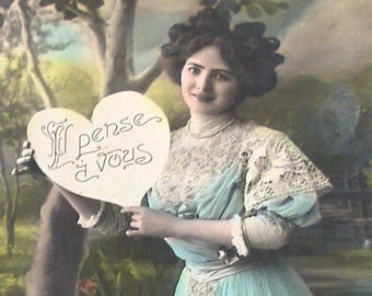 1900s French postcard Edwardian lady with heart.  RPPC real photo, paper ephemera.