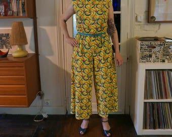 vintage groovy 70s yellow sleeveless jumpsuit abstract geometric swirl print oversize 1970s