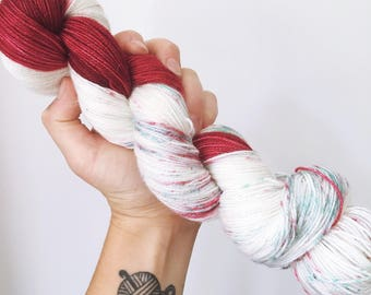 Peppermint Bark (red) - Hand dyed 4ply/sock yarn 100g/400m superwash merino, nylon blend with sparkle