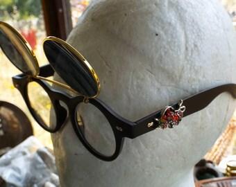 Round glasses, Flip Up shade, jeweled Bull, Steampunk, Customized, thick matt black plastic frames, retro,  festival, cosplay, convention