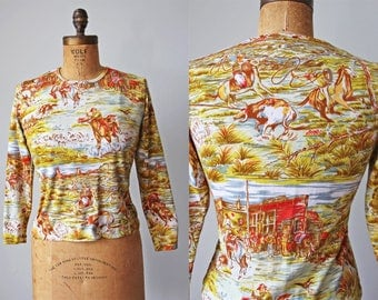 1960s Novelty Print Top - 60s Western Tee Shirt - Vintage Picture Knit Top w Cowboys and Old West Scene XS to M - Rustle Up T Shirt