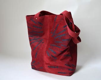 Red leather tote with dark blue print