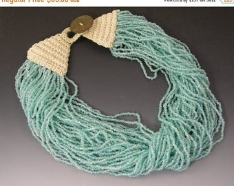 45% off Sale Blue Glass Torsade Necklace with Crocheted Clasp and Button