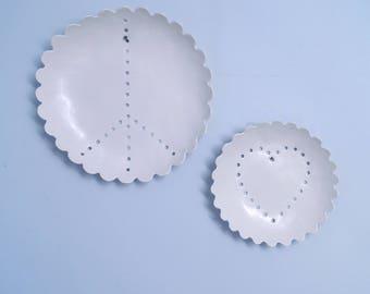 PEACE AND LOVE porcelain wall art. Set of two white ceramic plates scalloped edges geometric hole design white glaze porcelain fruit bowls