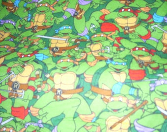Teenage Mutant Ninja Turtles on green -  Flannel Fabric  - 13 inches wide and sold by the yard