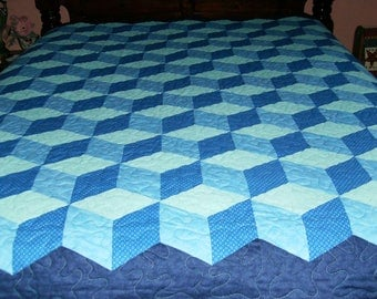 Tumbling Block Full Size Quilt in colors of blue, green, and navy!