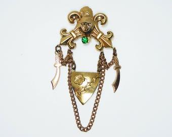 Art Deco Gold Tone Brooch - Chains, Scimatar Swords, Triangle Shield - Flur De Lis Crown, Green Rhinestone - Vintage 1980's Revival Jewelry
