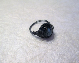 Beaded wire wrap ring, teal bead with black stripes, size 8 1/4