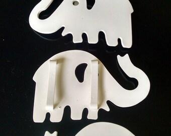 vintage white plastic elephant belt buckles set of 3