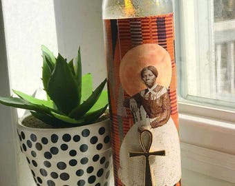 We out. -Harriet Tubman candle ancestor