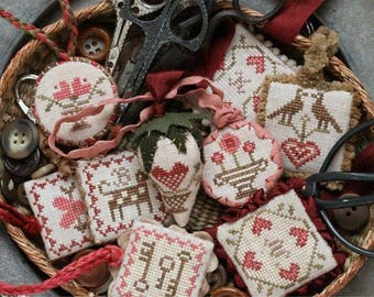 HEARTSTRING SAMPLERY Festive Little Fobs #1 series counted cross stitch patterns at thecottageneedle.com Valentine's