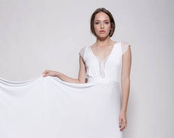 Simple white wedding dress , lace cleavage and sleeves ,floor length bell shape skirt