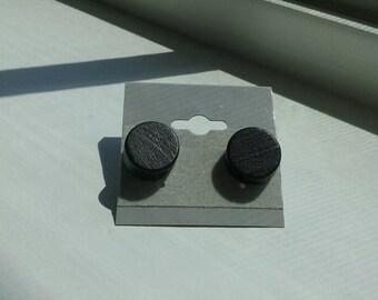 Black wooden studs